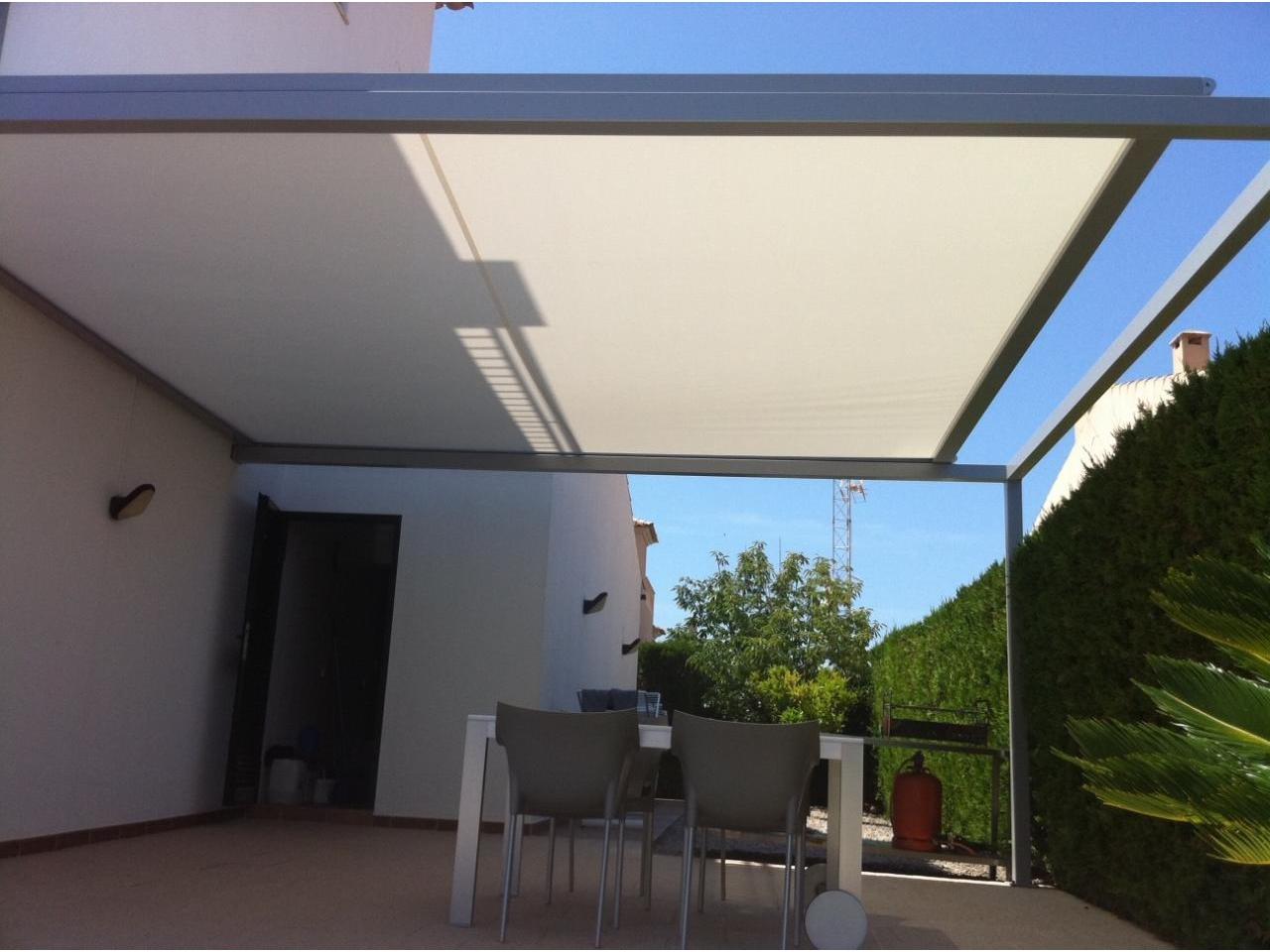 Trabajos cat logos art tendal toldos cofre parasoles for Toldos para terrazas economicos